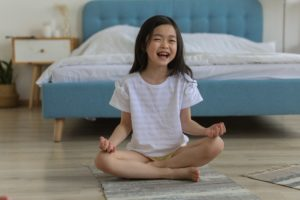 kids yoga laughing girl